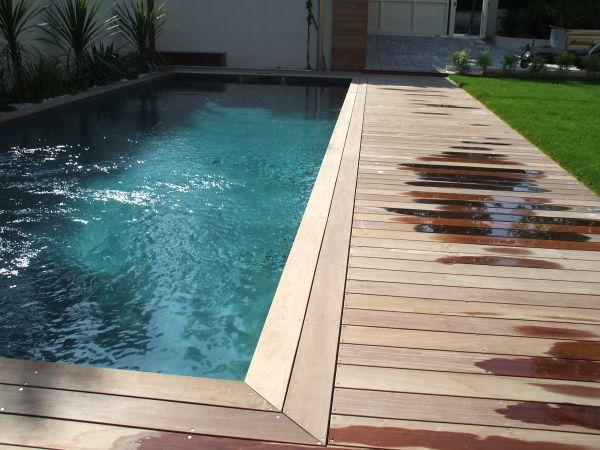 Entourage d 39 une piscine en ip dans une maison - Piscine entourage bois ...